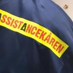 Annandagsbandy med Assistancekårens logo på tröjan